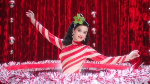 Katy Perry and Santa get a massage in 'Cozy Little Christmas' video